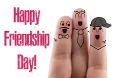 fond blanc d'isolement par ami de doigts Jour international heureux d'amitié Photo stock