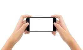 fond blanc d'isolement par téléphone de participation de main de femme image stock