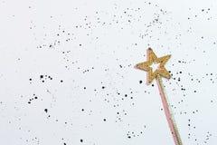Fond blanc de baguette magique magique d'étoile de concession de souhait photos stock