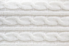 Fond blanc de chandail de laine Photographie stock libre de droits
