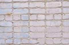 Fond blanc de mur de briques Texture d'un mur en pierre Mur de briques teint dans la couleur blanche Image stock