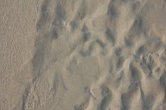 Fond blanc de plage de sable Photographie stock