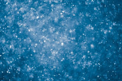 Fond bleu abstrait de flocons de neige Images stock