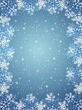 Fond bleu avec des flocons de neige Images stock