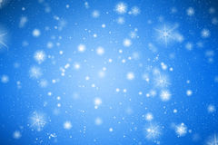 Fond bleu avec les flocons de neige blancs Image stock