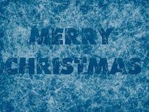 Fond bleu congelé par Noël avec le titre de Joyeux Noël Image stock