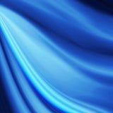Fond bleu d'abrégé sur texture de tissu en soie de vague Image stock