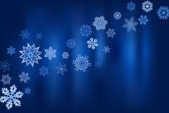 Fond bleu d'hiver avec des flocons de neige et endroit pour le texte Photographie stock libre de droits