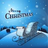 Fond bleu d'hiver de Noël avec le traîneau de Santa Photo stock