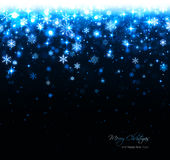 Fond bleu de Noël avec des étoiles et des flocons de neige photographie stock libre de droits
