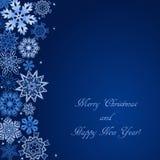 Fond bleu de Noël avec des flocons de neige sur le côté et avec le texte Images stock