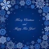 Fond bleu de Noël avec le cadre et le texte de flocons de neige Photos stock