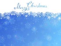 Fond bleu de Noël avec le texte manuscrit Images stock