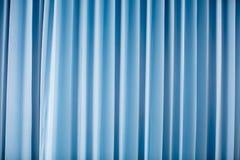 Fond bleu de rideau Photo stock