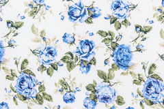 Fond bleu de Rose Fabric, fragment de rétro texte coloré de tapisserie Photo libre de droits