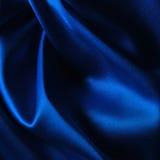 Fond bleu de satin Images stock