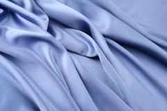 Fond bleu de satin Image libre de droits