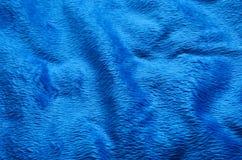 Fond bleu de tapis de tissu Photo stock