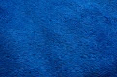 Fond bleu de tapis de tissu Photos stock