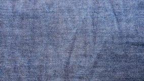 Fond bleu de tissu de jeans de denim Photo libre de droits