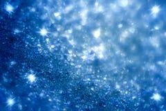 Fond bleu-foncé d'étincelles d'étoile et de scintillement Photo stock