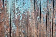 Fond bleu gris de vieux panneaux en bois d'une barrière rurale Photographie stock