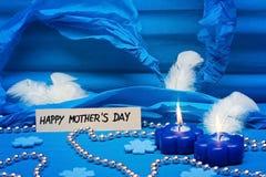 Fond bleu pour le jour de mères Photos stock