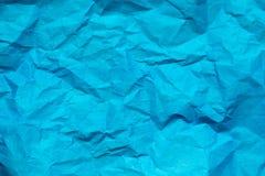Fond bleu, texture de papier colorée chiffonnée images stock