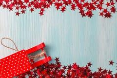Fond bleu vert avec les épices chaudes, la mandarine et l'étoile d'hiver Image libre de droits