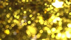 Fond brillant brouillé d'or banque de vidéos