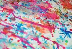 Fond brouillé d'aquarelle dans des couleurs oranges bleues en pastel, roses, violettes Photo libre de droits