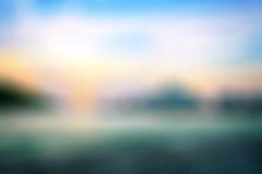 Fond brouillé d'un coucher du soleil de mer Images stock