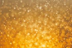 Fond brouillé de lumière d'abrégé sur bokeh de scintillement d'or Photos libres de droits