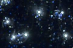 Fond brouillé des lumières de lumières de Noël et d'arbre de Noël, beau bokeh images stock