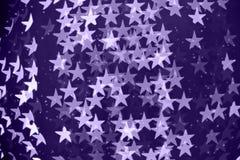 Fond brouillé en forme d'étoile de bokeh avec des étincelles Ultra-violet images libres de droits