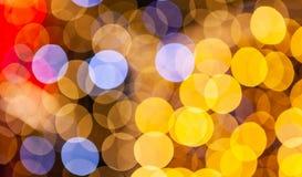 Fond brouillé jaune, bleu et rouge de lumières photos libres de droits