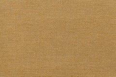 Fond brun clair d'un matériel de textile avec le modèle en osier, plan rapproché photo stock