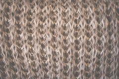 Fond brun de laine tricoté de texture Macro, plan rapproché Rétro modifié la tonalité Image stock