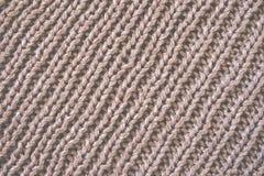 Fond brun de laine tricoté de texture Macro, plan rapproché Rétro modifié la tonalité Photo stock