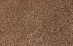 Fond brun en cuir ou matériel texturisé en cuir Photographie stock libre de droits
