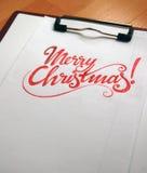 Fond calligraphique de Joyeux Noël images stock