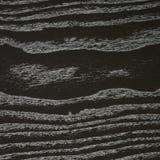 Fond carré avec une fin sur un bois noir veiné Images stock