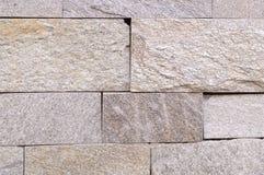 Fond carrelé en pierre superficiel par les agents de mur Texture photos libres de droits