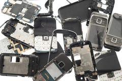 Fond cassé de téléphones Images libres de droits