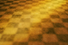 Fond Checkered jaune chaud Image stock