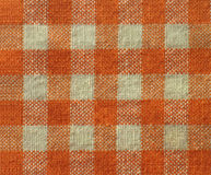 Fond checkered orange de tissu de texture de toile Images stock