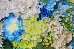 Fond coloré artificiel de fleurs Photos libres de droits