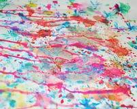 Fond coloré brouillé d'aquarelle dans des couleurs oranges bleues en pastel, roses, violettes Image libre de droits