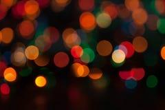 Fond coloré de bokeh de guirlande de Noël Photographie stock libre de droits