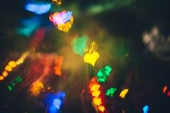 Fond coloré de coeur de bokeh de Noël brouillé par résumé Photo stock